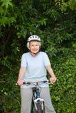 Mature woman mountain biking outside Royalty Free Stock Photos
