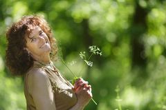 Mature woman in nature Stock Photography