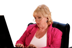 Mature woman needs reading glasses Stock Image