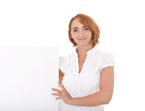 Mature woman next to white space Stock Images