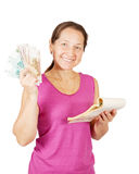 Mature woman with notebook and money Stock Photography