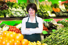 Mature woman offering fresh fruits and vegetables Royalty Free Stock Photo