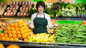Mature woman offering fresh fruits and vegetables Stock Images