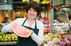 Mature woman offering watermelon Stock Photography