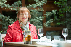 Mature woman at outdoor restaurant Stock Photo