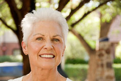 Mature woman in outdoor setting Stock Photo