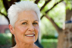 Mature woman in outdoor setting. Full face view of an attractive woman in an outdoor setting Stock Photography