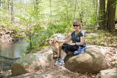 Mature Woman outdoors with dog Stock Image