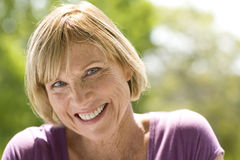 Mature woman outdoors, smiling, portrait Royalty Free Stock Photo