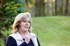 Mature woman outside on phone Stock Photography