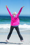 Mature woman outstretching her arms Stock Photography