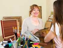 Mature woman paints a portrait Stock Image