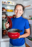Mature woman with pan Royalty Free Stock Images