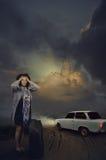 Mature woman panics when left alone at night road Stock Photos