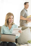 Mature Woman Paying Bills Using Laptop At Home Stock Image