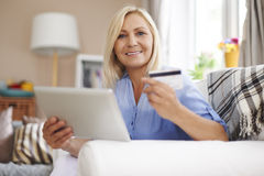 Mature woman paying by credit card Stock Photo
