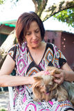Mature woman petting her dog Royalty Free Stock Photo