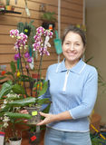 Mature woman with Phalaenopsis orchid Stock Photography
