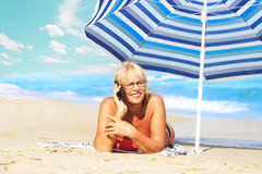Mature woman and a phone Royalty Free Stock Image