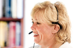 Mature woman phone headset Royalty Free Stock Images