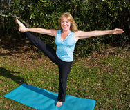 Mature Woman Pilates - Leg Stretch Royalty Free Stock Photos