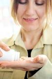 Mature woman with pills Stock Photos