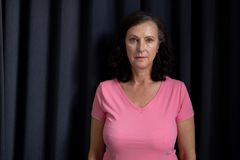mature women in pink for breast cancer royalty free stock images