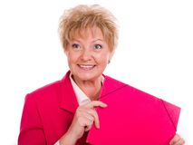 Mature woman with a pink folder Royalty Free Stock Photos