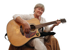 Mature woman playing acoustic guitar Stock Image