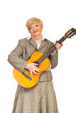 Mature woman playing acoustic guitar Royalty Free Stock Photo