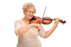 Mature woman playing an acoustic violin Stock Photography