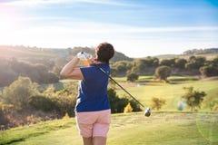 Mature woman playing golf Stock Image
