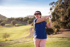 Mature woman playing golf Royalty Free Stock Photo