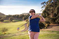 Mature woman playing golf Royalty Free Stock Image