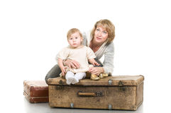 Mature woman playing with little child Stock Images