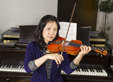 Mature woman playing the violin Stock Photo