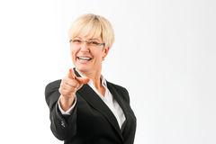 Mature woman point finger on the viewer Royalty Free Stock Image