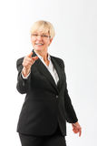 Mature woman point finger on the viewer Royalty Free Stock Photos