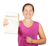 Mature woman  pointing  blank notebook Stock Photo