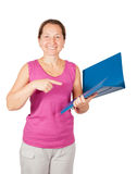 Mature woman pointing at documents Royalty Free Stock Images