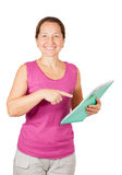 Mature woman pointing at documents Stock Photography
