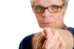 Mature woman pointing a finger Stock Photo