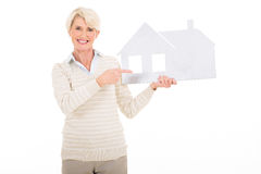 Mature woman pointing house Stock Photography