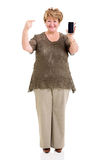 Mature woman pointing smart phone Royalty Free Stock Photo