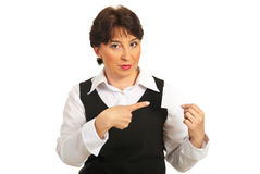 Mature woman pointing to blank card Royalty Free Stock Photography