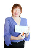 Mature woman pointing to date in calendar Royalty Free Stock Image