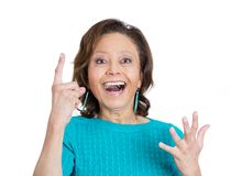Mature woman pointing up Royalty Free Stock Images