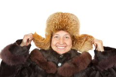Mature woman in polar fox cap Royalty Free Stock Photos