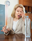 Mature woman with  poor quality water Royalty Free Stock Photography