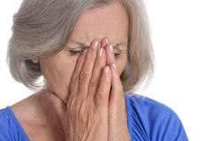 Mature woman portrait closing her face Stock Photo
